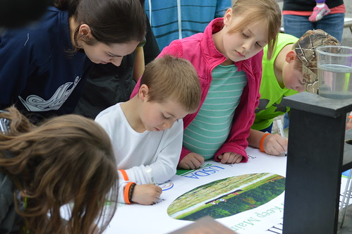 Children from Hartland sign an Earth Day Banner on Earth Day pledging to keep the environment in Maine clean.