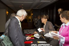 Staff assisting guest with registration