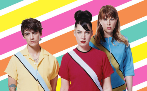 The three members of Le Tigre in funny bright dresses