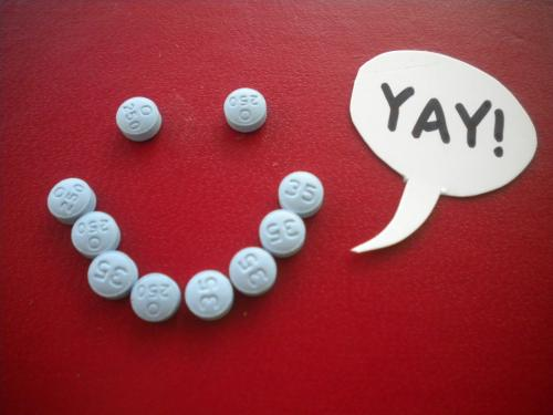 Birth control pills making a smiley face