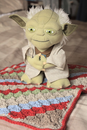 Toy Yoda with his blanket by Helen in Wales