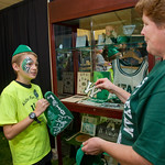 hmc016 -- University Archivist Meg Miner tells 12-year-old Tyler Trucko about freshman beannies, letter jackets and other memorabilia.