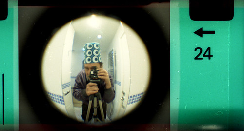 reflected self-portrait with Fisheye Baby camera and halloween hat by pho-Tony