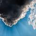 Sun hiding behind a small cloud by Sharad Medhavi