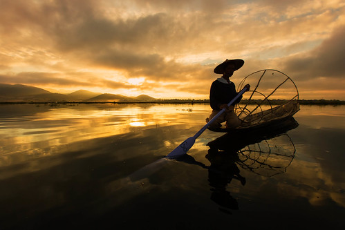 travel vacation water colors silhouette sunrise canon reflections geotagged boat fisherman fav50 burma myanmar inlelake tradition bagan natgeo fav10 fav25 nationalgeographicexpeditions 1dx alexstoen alexstoenphotography canoneos1dx