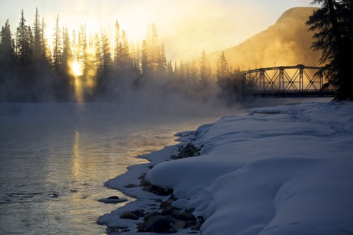 bridge trees winter light shadow sun mist mountain snow canada cold reflection castle ice water fog sunrise river flow rocks rocky junction alberta bow banff