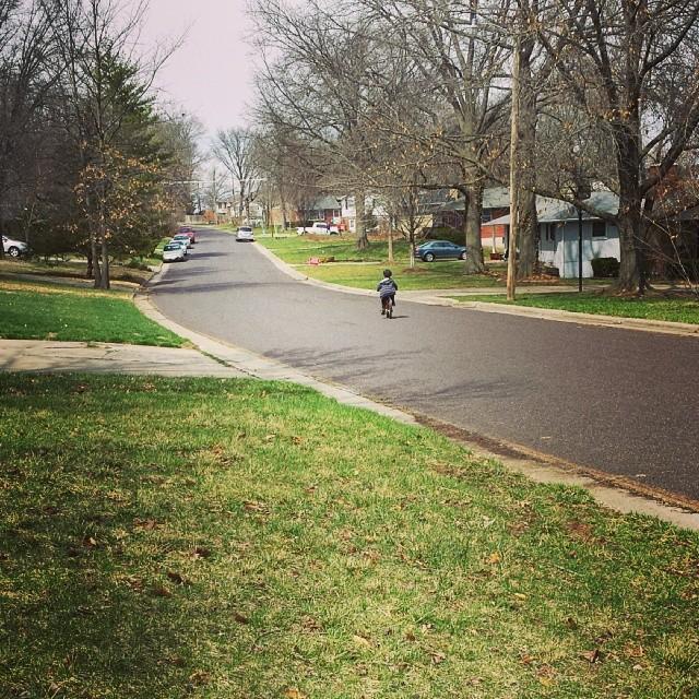 H rides his #bike down our #street .