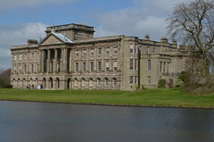 A view across the lake of the National Trust stately home of Lyme Park the largest home in Cheshire....