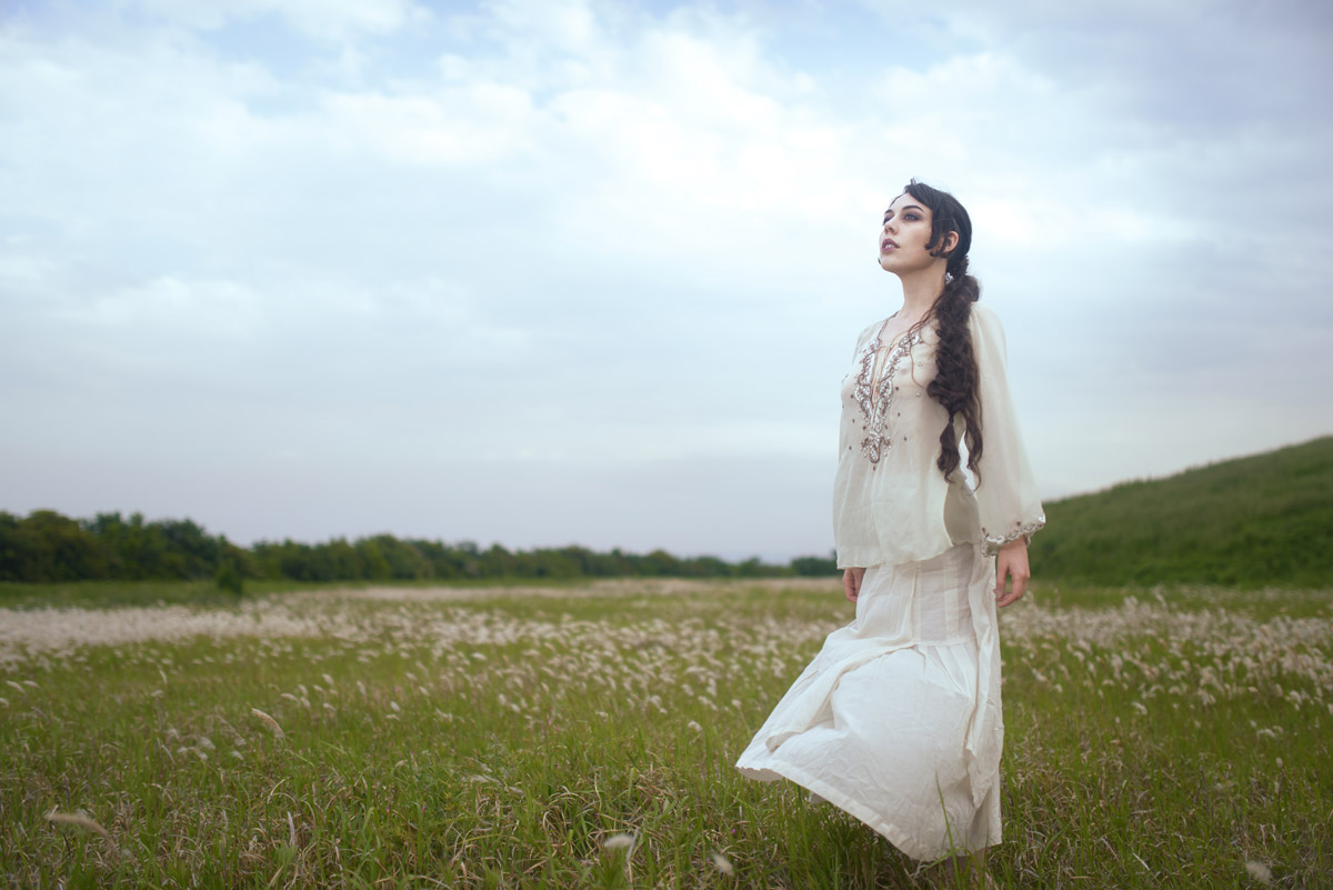 Gestalta photographed by Akiomi Kuroda. Model in long white dress in a Japanese landscape.