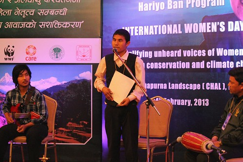 Visually challenged participant Toya Bishwakarma sings his song feeling the lyrics on a braille paper. © WWF Nepal, Hariyo Ban Program/ Pallavi Dhakal