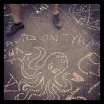 "Ainur's octopus (but she did not write ""David is stupid"") - chalk drawings at #sarjakuvafestivaalit"