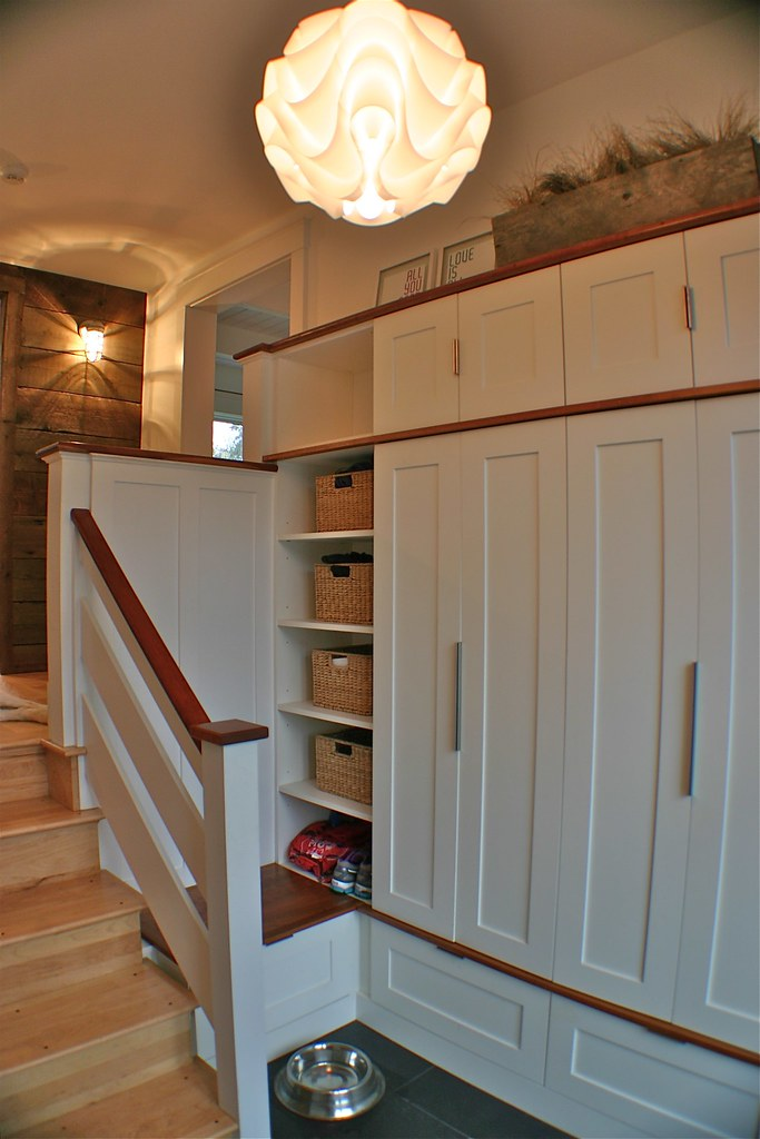 this family entry hall has it all, concealed storage for kid's clutter and even space for the family dogs.