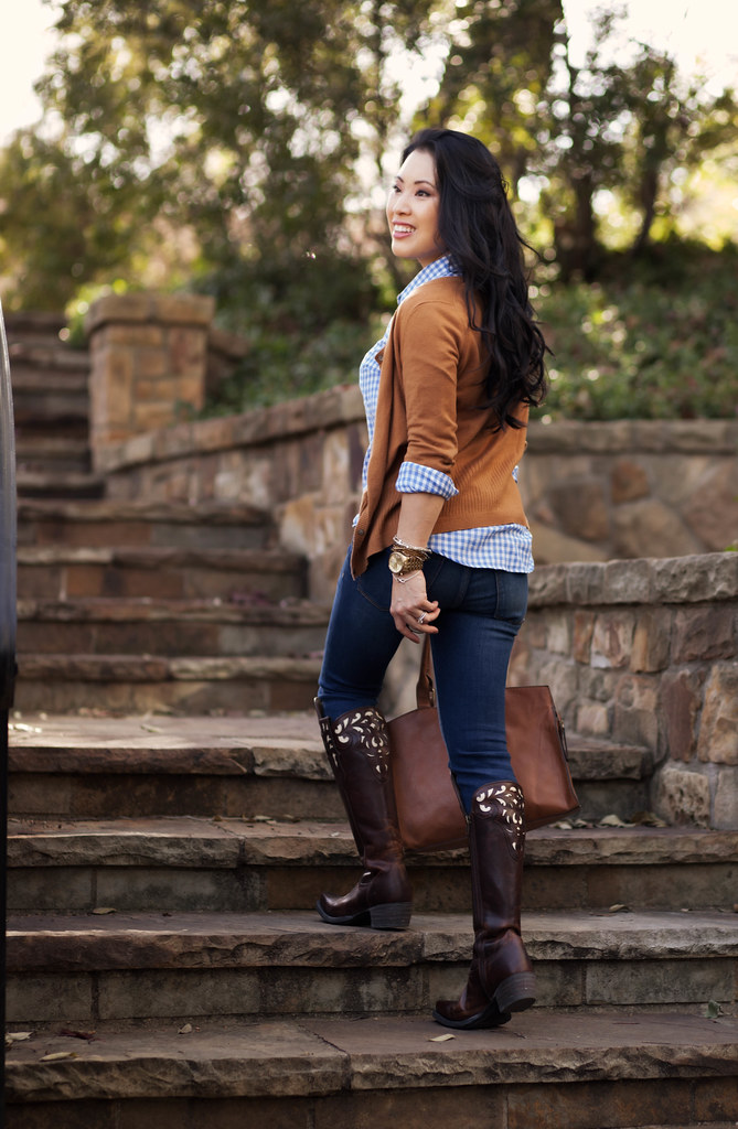 cute & little blog | equestrian chic | tan cardigan, blue gingham shirt, skinny jeans, ariat hacienda equestrian over-the-knee boots, statement necklace outfit