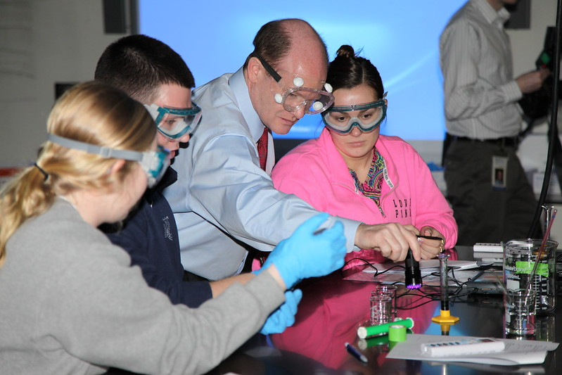 Senator Coons works with biochemistry students at UD on February 20, 2014