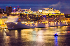 Just before sunrise, Coast Guard boat is patrolling Port Everglades' North Port area — the Royal Princess