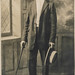 Small photo of African American man posing with a cane