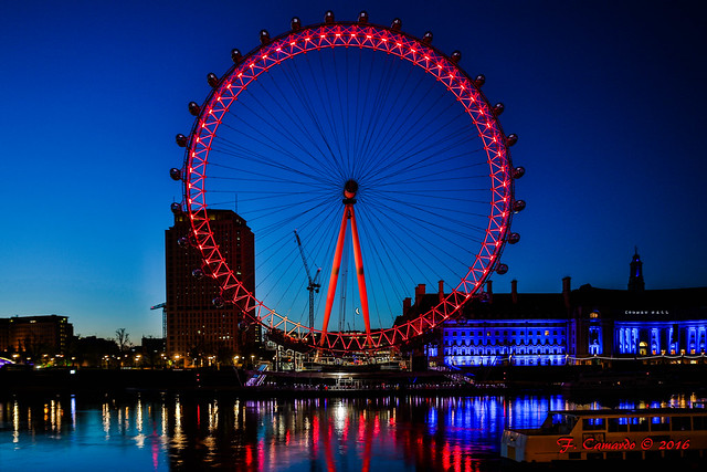 Night becomes day and the Moon gently hides behind the London Eye