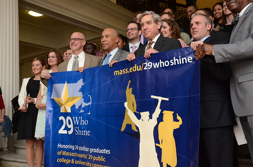 29 Who Shine honorees pose with Representative Tom Sannicandro, Governor Deval Patrick, Commissioner Richard Freeland, and Secretary Matthew Malone.