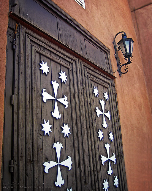 The beautifully carved wooden mission doors at Santa Cruz de la Canada mission.