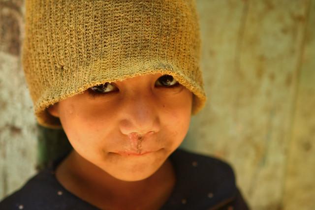 Nepali boy in a green knitted hat. Kathmandu 2009