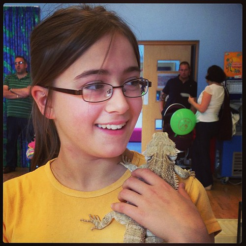 Holding a bearded dragon.