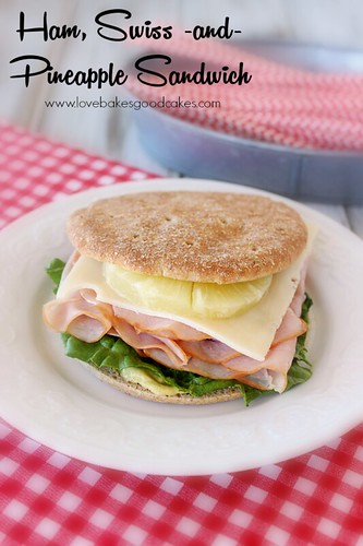 Ham, Swiss and Pineapple Sandwich on a white plate.