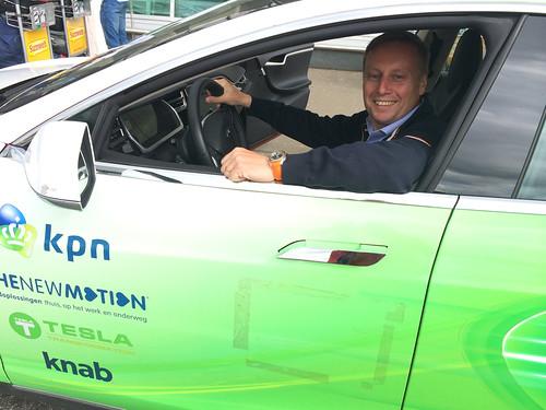 Marc driving a Tesla