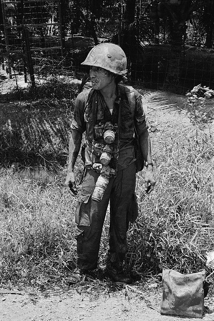 Cai Lay, South Vietnam 1972 - UPI staff photographer Willie Vicoy is covered with mud