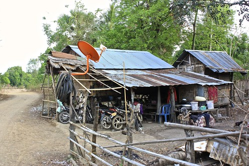 three motorbikes and satellite tv. all the essentials in life at this bamboo shack.