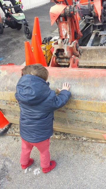 He got up the courage to touch the digger!