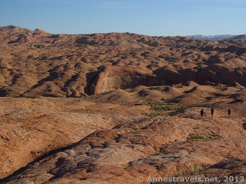 Hiking down the slickrock - the deep shadows indicate where Coyote Gulch is, and the large fin to the left of center is Jacob Hamblin Arch. Grand Staircase-Escalante National Monument, Utah