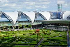 Domestic terminal wing and shrine at Suvarnabhumi airport in Bangkok