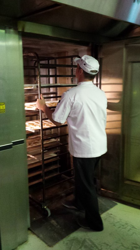 Cookies going into an industrial oven