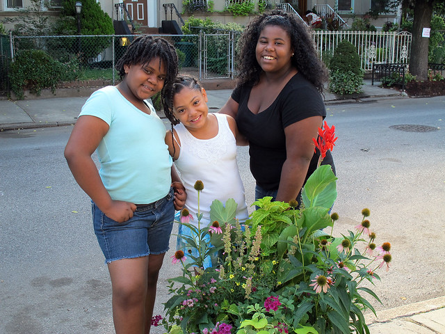 Sylvia, Ashley, and Raven serve as part of the watering crew for the gorgeous containers on their winning block—East 25th Street between Clarendon Road and Avenue D. Photo by GreenBridge staff.