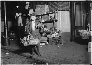 At center market. 11 year old celery vender. He sold until 11 P.M. and was out again Sunday morning selling papers and gum. Has been in this country only half a year. Washington D.C., 04/13/1912