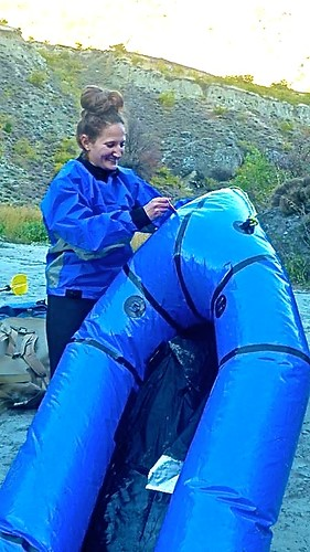 Lina setting up her packraft outside of Queenstown New Zealand with Expedition X