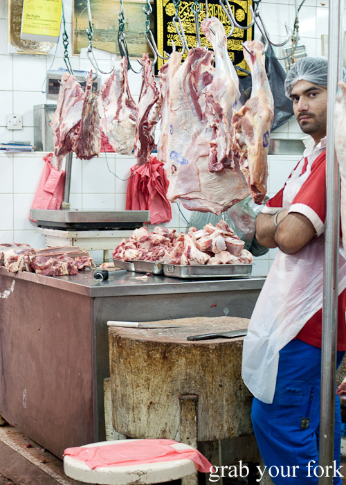 Butcher and hanging meats next to Dubai Fish Market in Deira