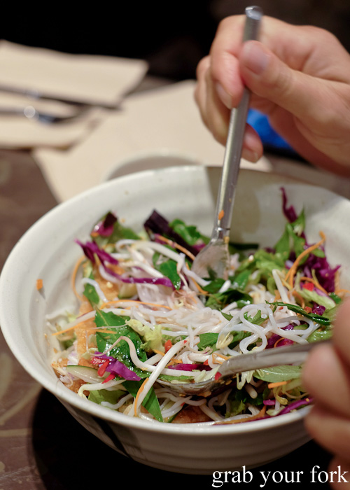 Tossing the rice noodle salad at Boon Cafe at Jarern Chai, Sydney