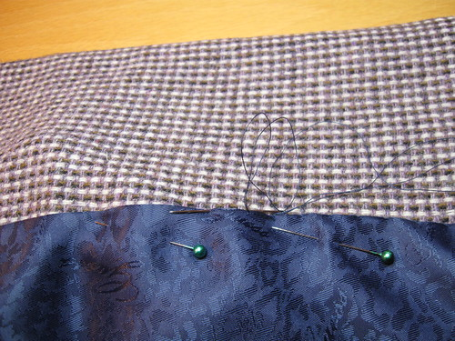 saler sewing in lining closeup