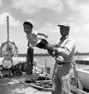 Fisherman with his son in Naples, Florida