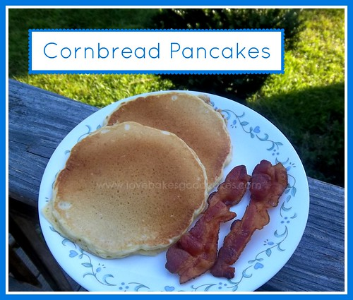 Cornbread Pancakes on white plate with two bacon slices.