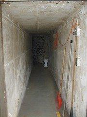 room(0.0), tunnel(0.0), bunker(1.0), floor(1.0), wall(1.0), air-raid shelter(1.0), infrastructure(1.0),