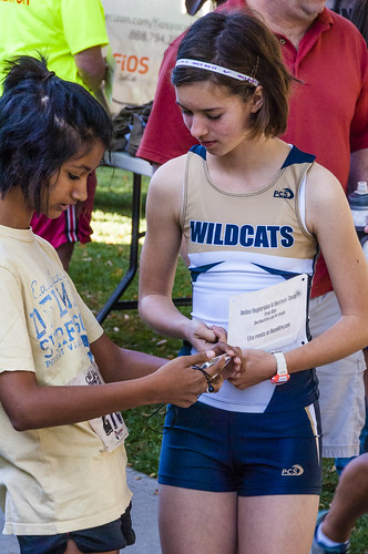 Racers pin their numbers at Old West Run by Crispin Courtenay, on Flickr