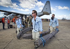 Australian Medical Assistance Team unload medical equipment and supplies