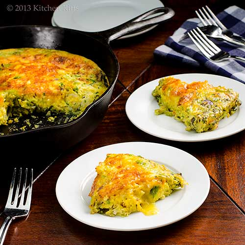 Frittata with Brussels Sprouts on plate, with skillet in background