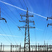 High voltage transmission lines carry electrical power.