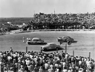 Drivers narrowly avoiding a stalled race car: Daytona Beach, Florida
