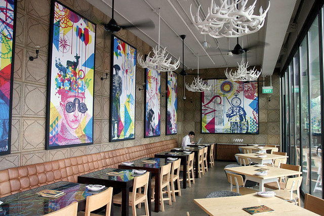 CMYK Dada inspired artwork juxtapose with handpainted Catalan tiles in the contemporary decor