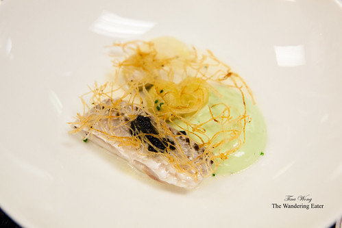 Poached striped bass with celery and potato rosti