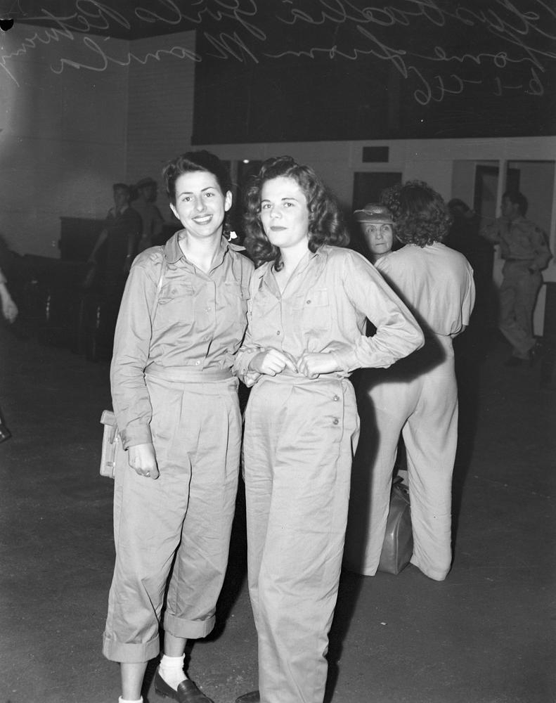 Two young women in uniform returning home from Manila, Brisbane 1946